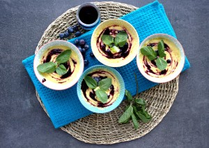 Mango mousse with blueberry coulis